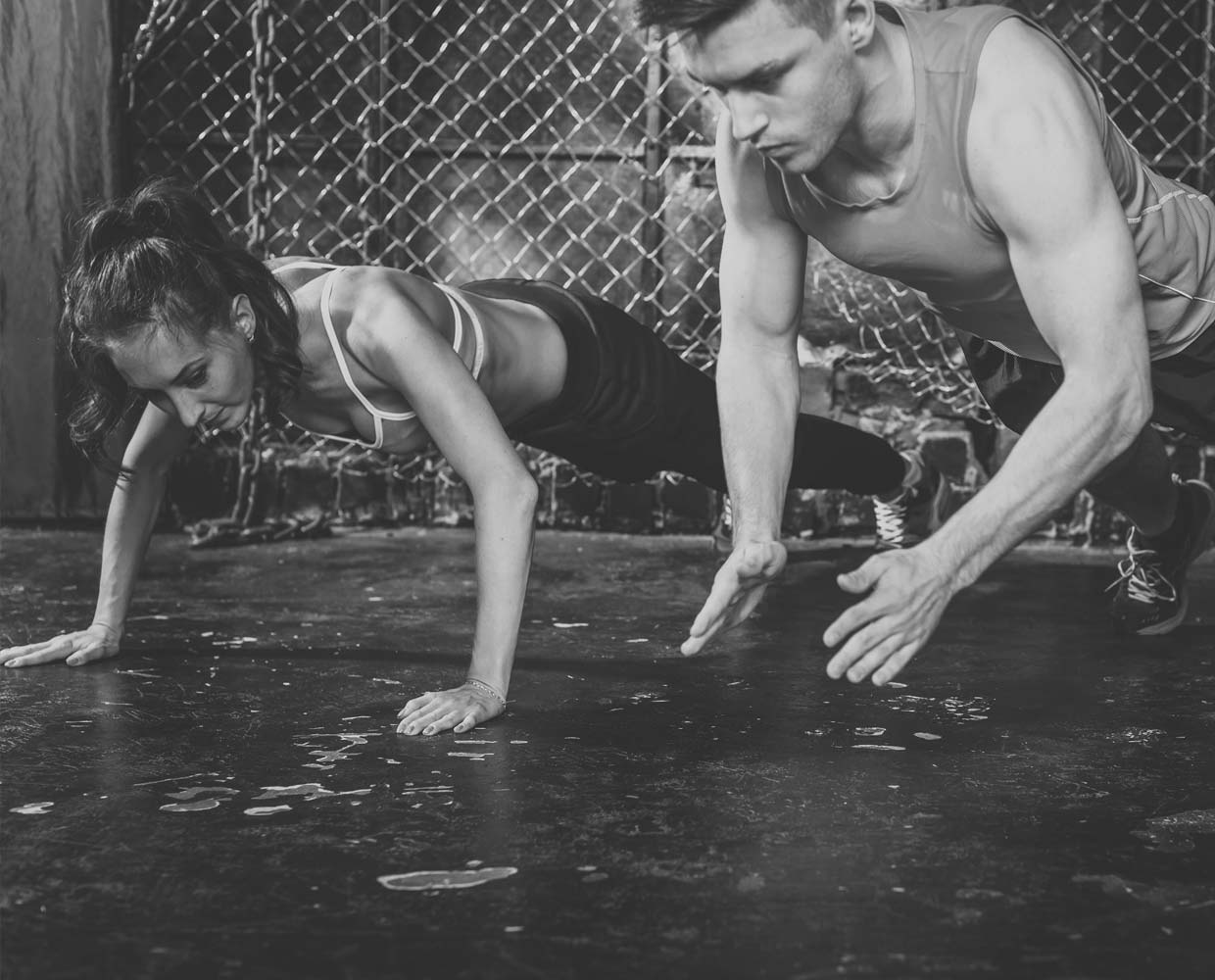 man and woman doing burpees