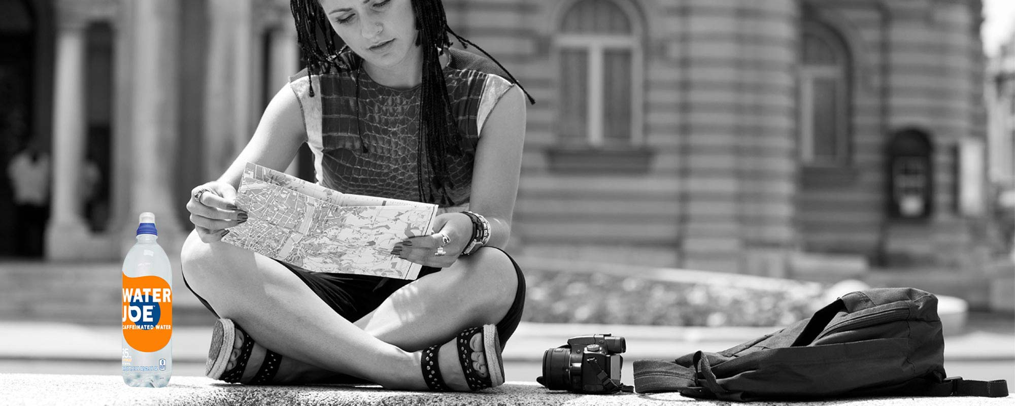 Girl reading a map with Water Joe